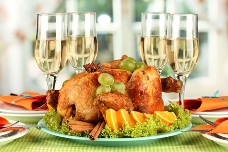 thanksgiving day: banquet table with roast chicken and glasses of wine. Thanksgiving Day