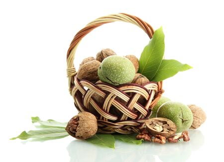 walnuts with green leaves in basket, isolated on white Stock Photo - 15388986