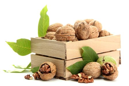 walnuts with green leaves in woooden crate, isolated on white Stock Photo - 15390353