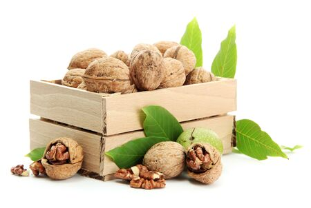 walnuts with green leaves in woooden crate, isolated on white Stock Photo - 15388985