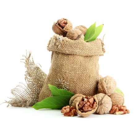walnuts with green leaves in  burlap bag, isolated on white Stock Photo - 15388961