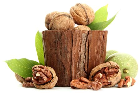walnuts with green leaves in woooden vase, isolated on white Stock Photo - 15391053