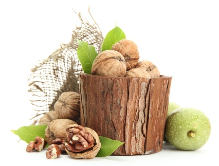 walnuts with green leaves in woooden vase, isolated on white Stock Photo - 15390171
