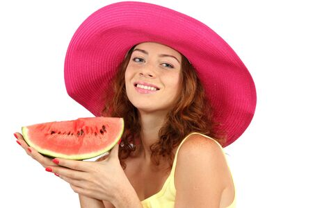 Smiling beautiful girl in beach hat with watermelon isolated on white photo