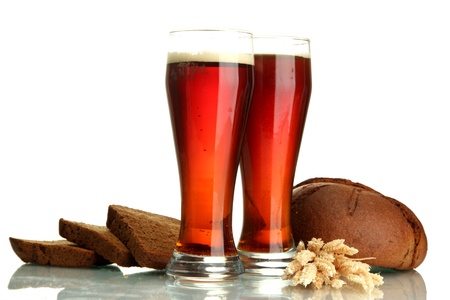 two glasses of kvass and rye breads with ears, isolated on white photo