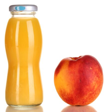 Delicious peach juice in glass bottle and peach next to it isolated on white Stock Photo - 15389600