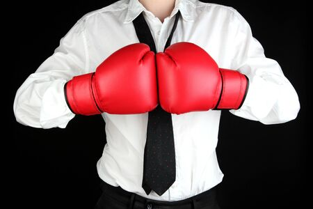 boxing gloves: businessman in boxing gloves isolated on black Stock Photo