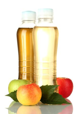 two bottles of juice with sweet apples, isolated on white photo