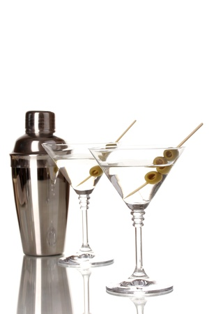 martini shaker: Martini glasses with olives and shaker isolated on white