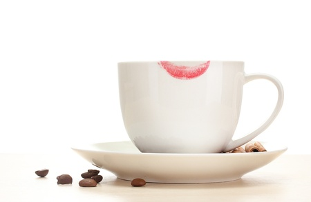 cappuchino: cup of coffee with lipstick mark beans and cinnamon sticks isolated on white