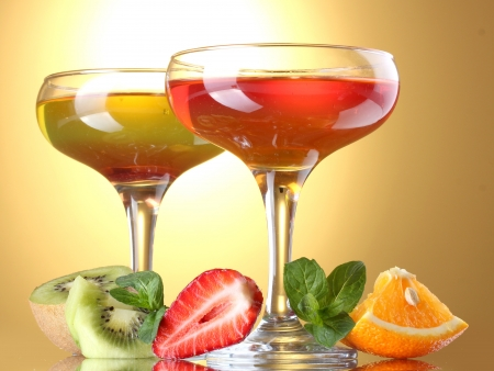 fruit jelly in glasses and fruits on yellow background Stock Photo - 15395882