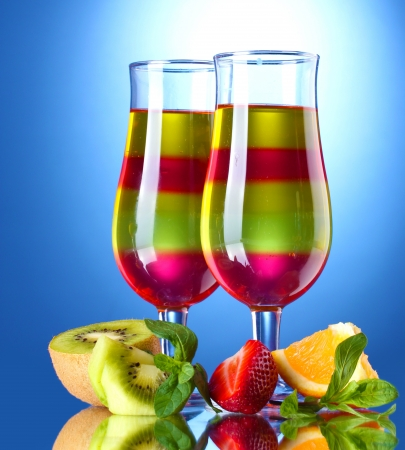 fruit jelly in glasses and fruits on blue background Stock Photo - 15395878