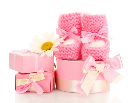 pink baby boots, gifts and flower isolated on white photo