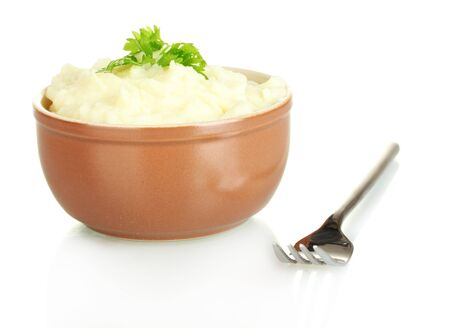 mashed potatoes: Mashed potato with parsley in the bowl isolated on white