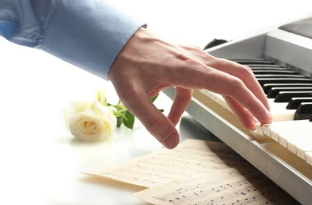 hand of man playing piano Stock Photo - 15419439