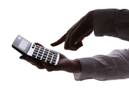 silhouette of womans hands with calculator isolated on white   photo