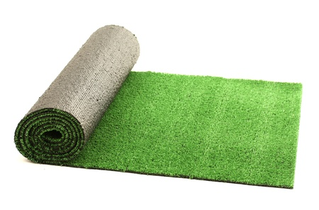 rug texture: artificial rolled green grass, isolated on white