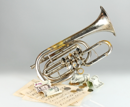 musical instrument with money on gray background photo