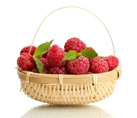 ripe raspberries in basket with mint  isolated on white Stock Photo - 15420638