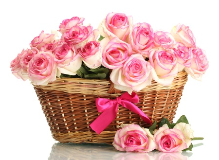 pink rose petals: beautiful bouquet of pink roses in basket, isolated on white Stock Photo
