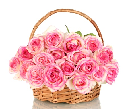 bunch up: beautiful bouquet of pink roses in basket, isolated on white Stock Photo