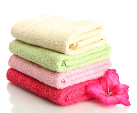 absorb: bright towels and flower isolated on white Stock Photo