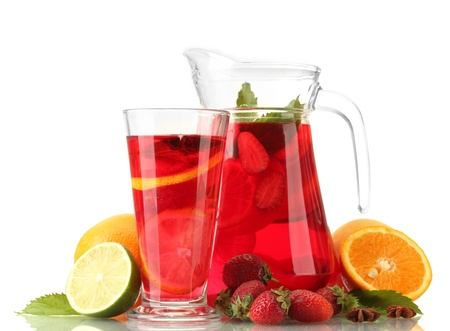 sangria in jar and glass with fruits, isolated on white photo