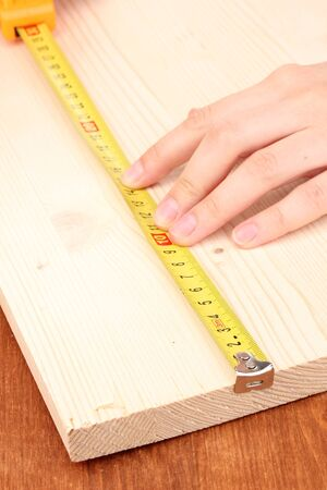 mesure: measuring wooden board close-up