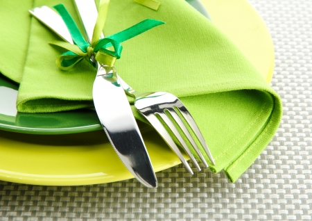 Green empty plates with fork and knife on a grey tablecloth Stock Photo - 15420111