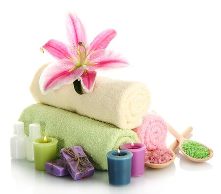 towels with lily, aroma oil,  candles, soap and sea salt isolated on white Stock Photo - 15415320