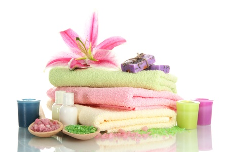 towels with lily, aroma oil,  candles, soap and sea salt isolated on white Stock Photo - 15417242