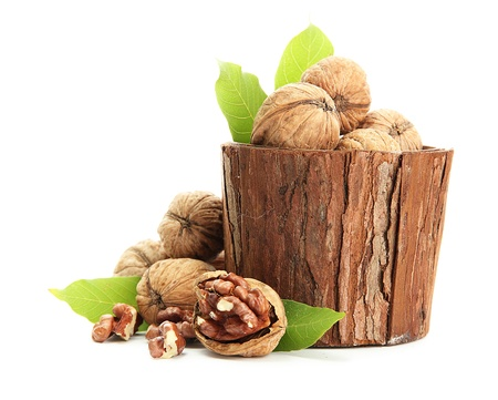 walnuts with green leaves in woooden vase, isolated on white Stock Photo - 15421522