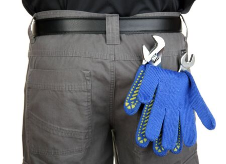 gloves and instruments in back pocket close-up photo