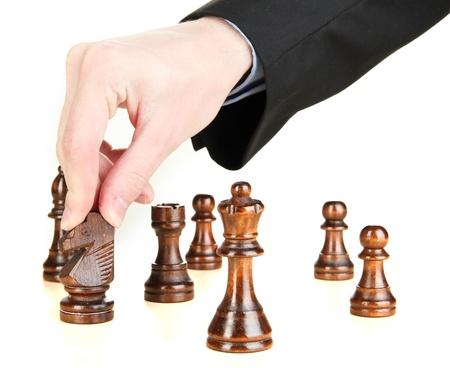 jugando ajedrez: hombre de negocios que juega ajedrez aislado en blanco Foto de archivo