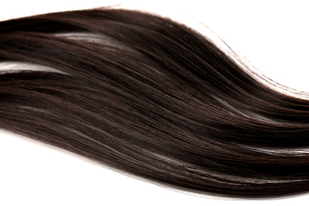 combed: Smooth brown hair close-up isolated on white Stock Photo