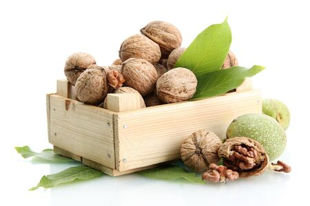 walnuts with green leaves in woooden crate, isolated on white Stock Photo - 15425467