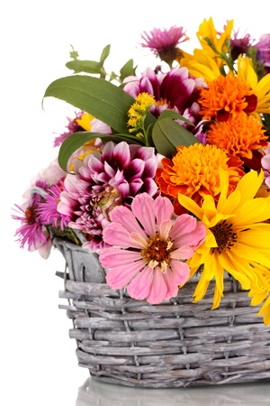 beautiful bouquet of bright flowers in basket isolated on white photo