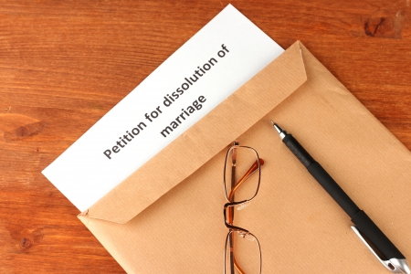 decree: Divorce decree and envelope on wooden background