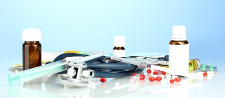 medicines and a stethoscope on a blue background close-up photo