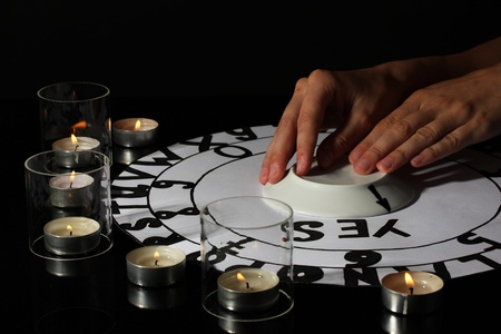 seance: spiritualistic seance by candlelight close-up