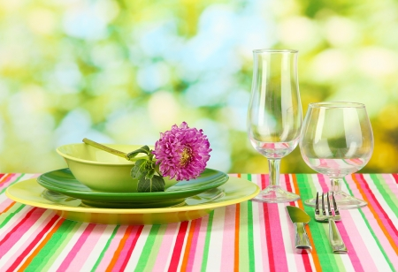 on the tablecloth: Table setting on bright background close-up Stock Photo
