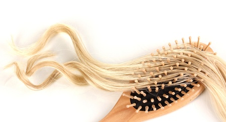 Blond curls brushing comb isolated on white Stock Photo - 15457512