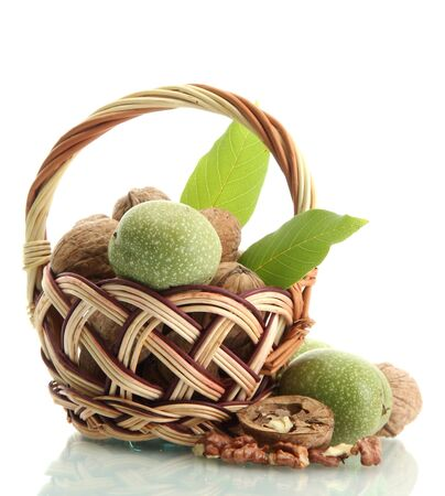 walnuts with green leaves in basket, isolated on white Stock Photo - 15457413