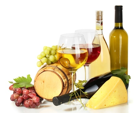 barrel, bottles and glasses of wine, cheese and ripe grapes isolated on white photo
