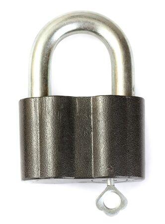 tarnish: old padlock with key isolated on white background Stock Photo