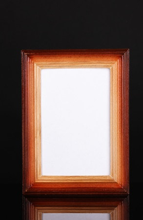 Wooden frame isolated on black photo