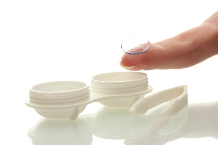 contact lenses in containers and tweezers, isolted on white photo