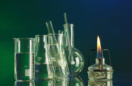 spiritlamp and test-tubes on  blue-green background photo