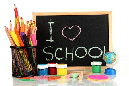teaching crayons: Piccolo banco di scuola con materiale scolastico vari close-up isolato su sfondo bianco Archivio Fotografico