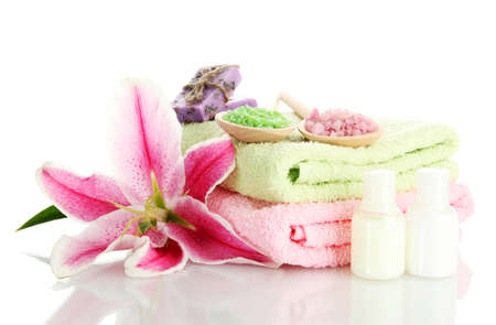 towels with lily, aroma oil, soap and sea salt isolated on white Stock Photo - 15549256